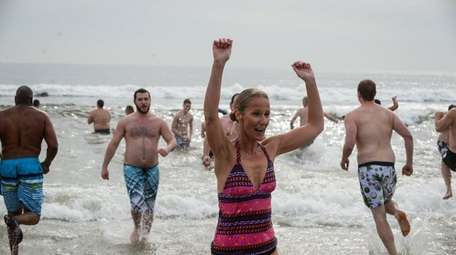 People run from the waters off Long Beach