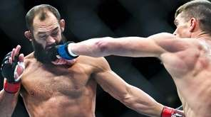 Welterweight Johny Hendricks takes a shot to the