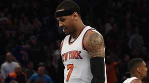 New York Knicks forward Carmelo Anthony walks to