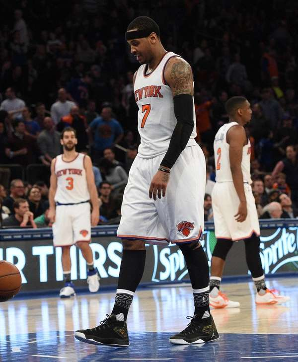 Knicks forward Carmelo Anthony walks to the sideline