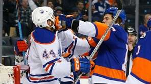 Matt Martin of the New York Islanders punches
