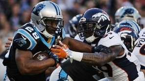 Carolina Panthers running back Jonathan Stewart, left, runs