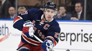 New York Rangers defenseman Ryan McDonagh passes the