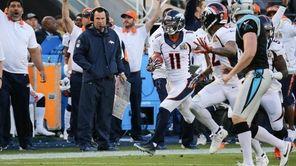 Denver's Jordan Norwood returns a punt for a