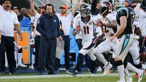 Denver's Jordan Norwood returns a punt for a