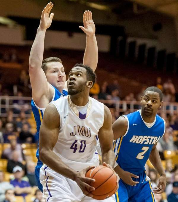James Madison's Yohanny Dalembert prepares to shoot against