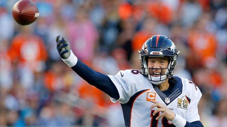 Peyton Manning attempts a pass during Super Bowl