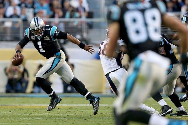 Cam Newton of the Carolina Panthers runs with