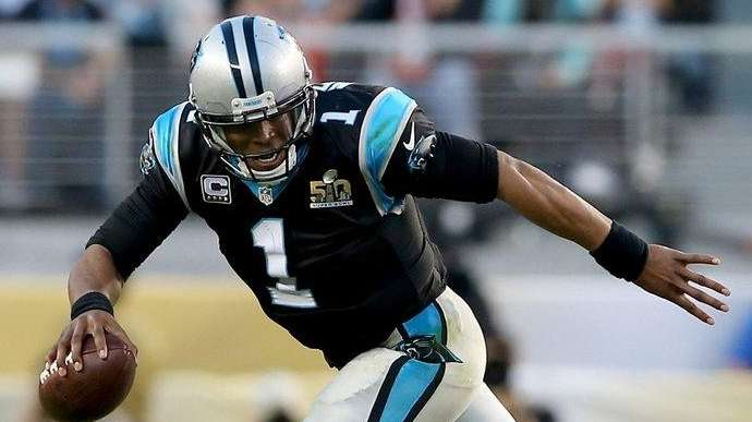 Cam Newton of the Carolina Panthers runs with