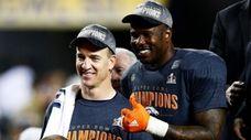 Peyton Manning and Von Miller of the