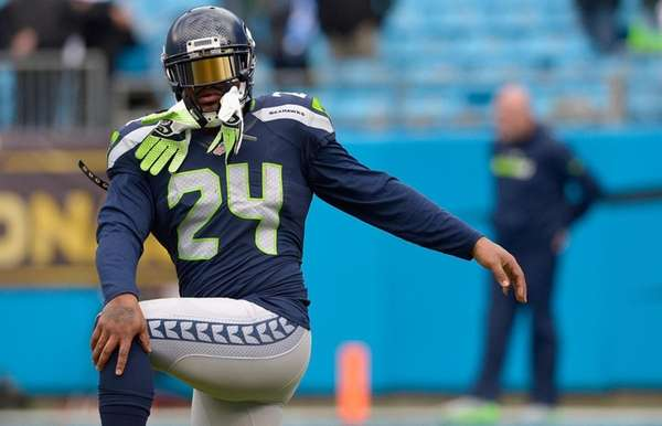 Marshawn Lynch of the Seattle Seahawks warms