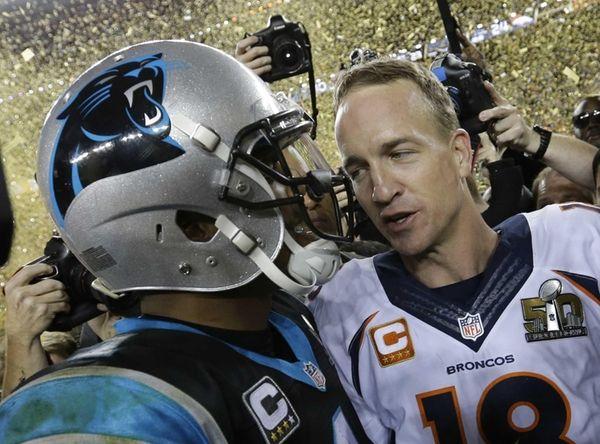 Carolina Panthers' Cam Newton, left, talks to Denver