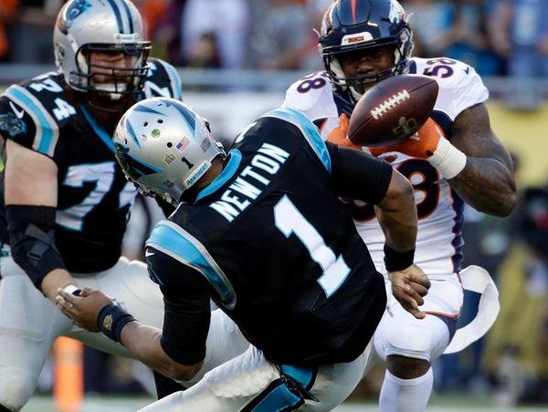 Denver Broncos linebacker Von Miller strips the ball