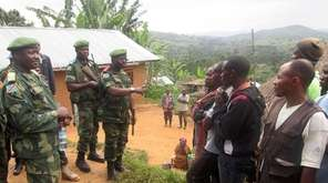 Congolese servicemen speak with people on January 7,