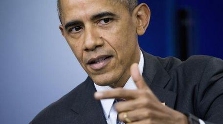 President Barack Obama speaks in the Brady Press