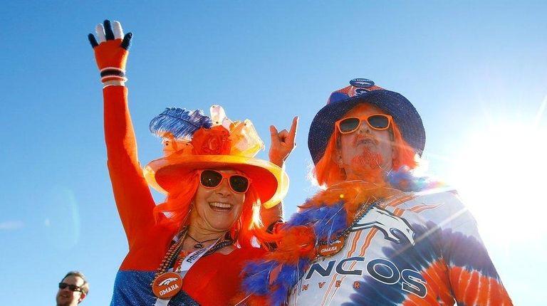 Fans of the Denver Broncos enter the