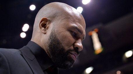 New York Knicks head coach Derek Fisher walks