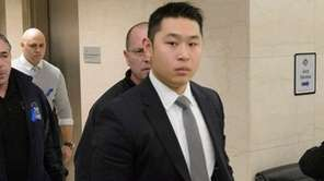 New York City Police Officer Peter Liang enters