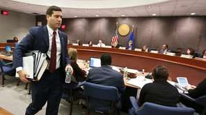 Acting Suffolk County Police Commissioner Timothy Sini leaves