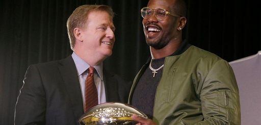 Denver Broncos linebacker Von Miller, right, holds the