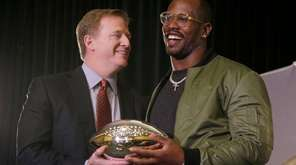 Denver Broncos linebacker Von Miller, right, holds the