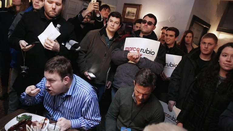 Customers eat their meals while surrounded by supporters