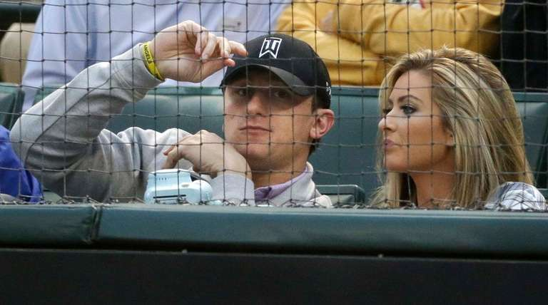 Johnny Manziel, left, sits with Colleen Crowley