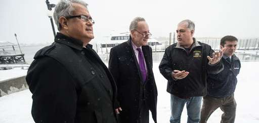 Sen. Chuck Schumer, second from left, is joined