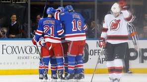 The New York Rangers celebrate a second-period