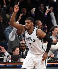 Brooklyn Nets forward Joe Johnson reacts after he