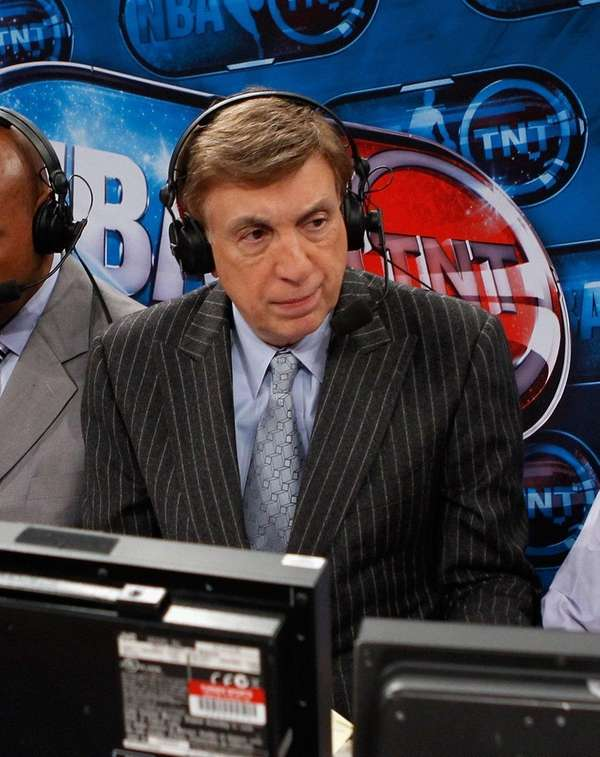 Broadcaster Marv Albert works a game between