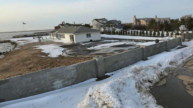 Neighbors have complained about nearly 6-foot wall, seen