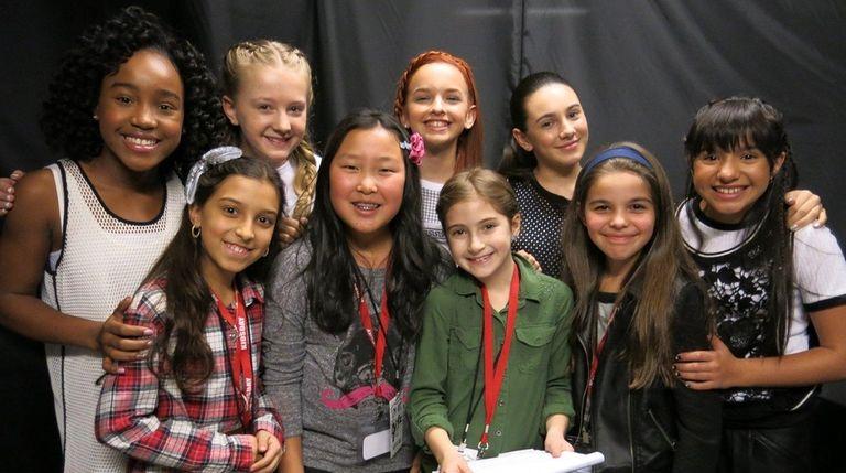 Kidsday reporters, forefront from left, Andrea Vases, Sophia