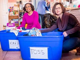 Patricia Campbell, left, and Eileen Koff declutter a
