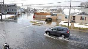 Flooded South Wellwood Avenue at River Avenue in
