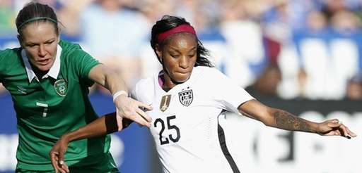 Crystal Dunn of the United States is defended