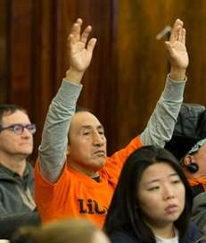 Onlookers watch the New York city council members