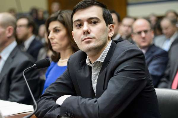 Former pharmaceutical executive Martin Shkreli listens during a