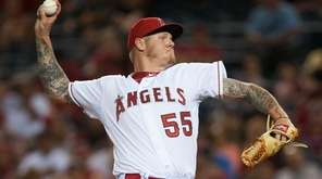 Los Angeles Angles pitcher Mat Latos throws