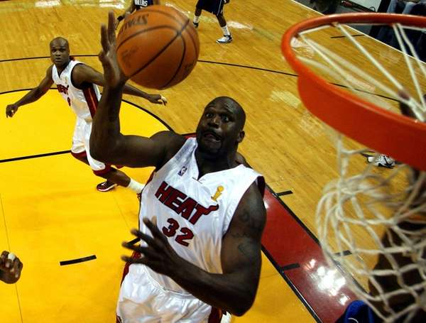 Miami Heat center Shaquille O'Neal (32) grabs