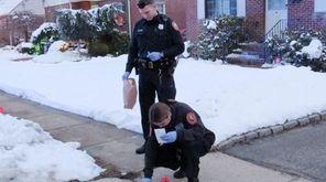 Nassau police investigate the scene on Henry Street