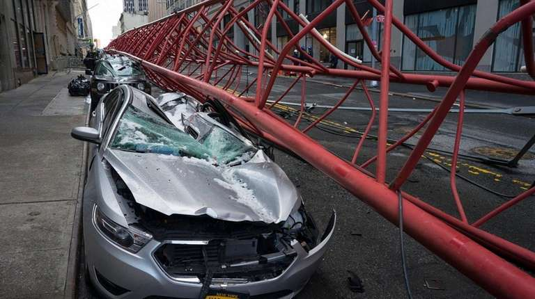Cars lay crushed in the aftermath of a