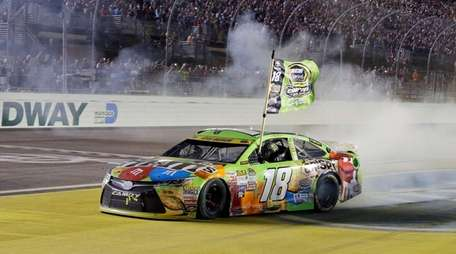 Kyle Busch celebrates after winning the NASCAR