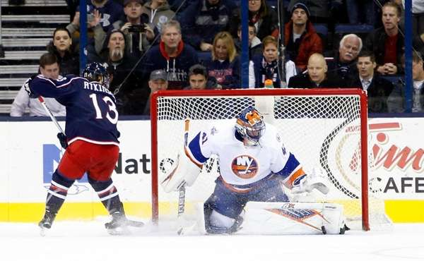 New York Islanders' Jaroslav Halak, right, of