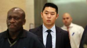 Police Officer Peter Liang leaves the courtroom during