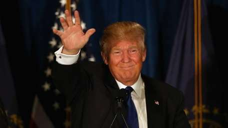 Republican presidential candidate Donald Trump waves to his