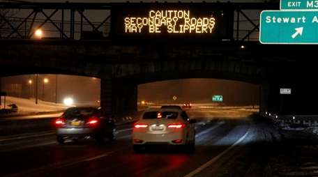 Cars travel on the northbound Meadowbrook State Parkway