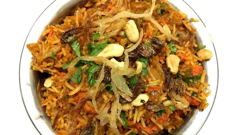 Kosher indian restaurant mumbai grill opens in great neck newsday chicken tikka biryani is one of the indian forumfinder Choice Image
