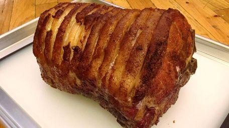 Reverse-seared pork is crisp on the outside but