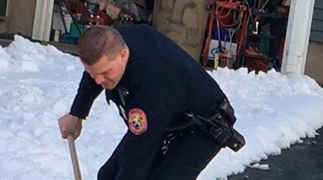 Gerard Cote, 82, watches Nassau police Officer Kyle